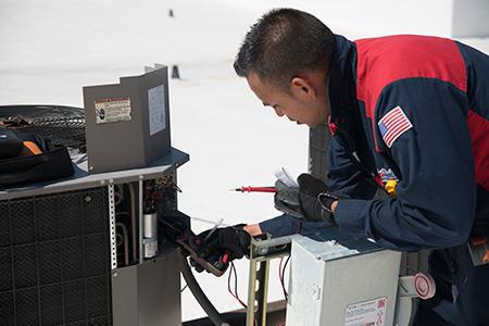 hvac technician repairing ac