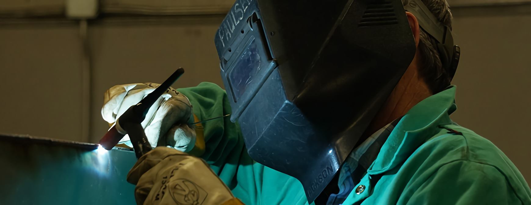 welder using torch