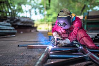 welder using flux cored arc welding