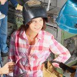 two female welders learning about metal