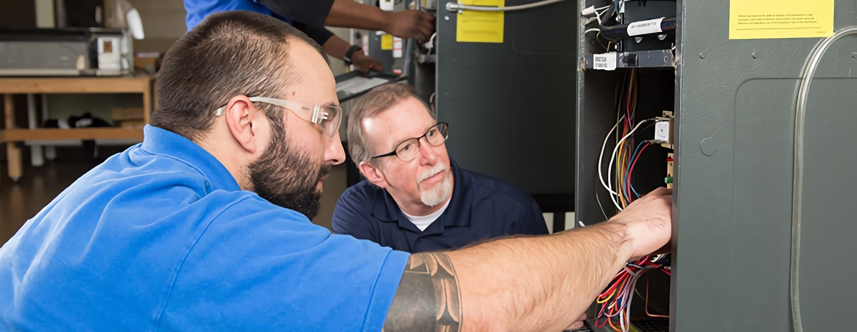 electrician student learning from instructor