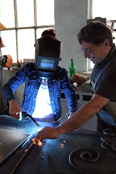 female learning how to weld