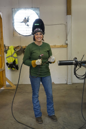 female welder in workshop