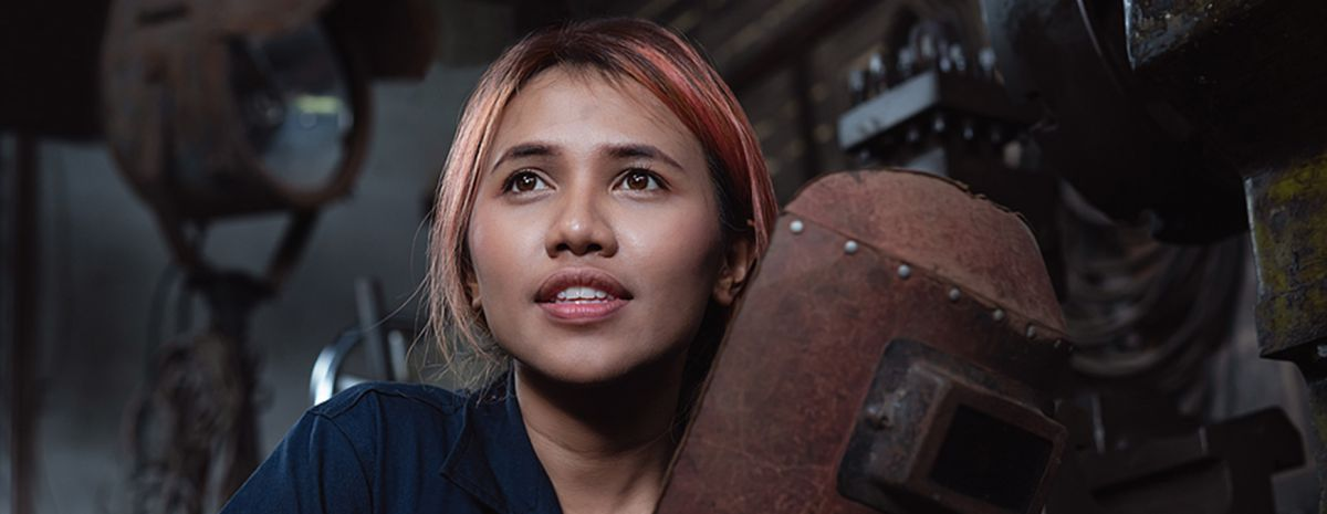 female welder with a skilled job