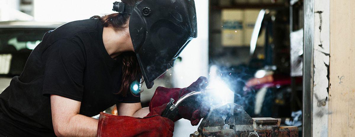 female welder working in shop