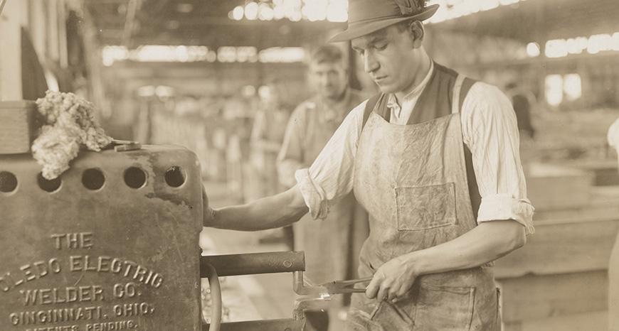 man using electric welding machine