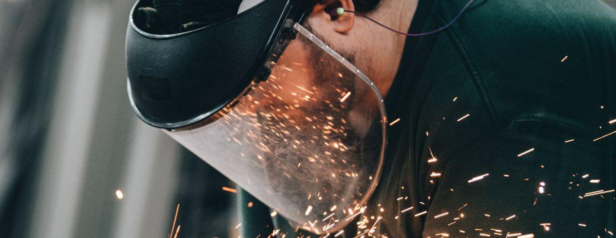 professional welder wearing mask