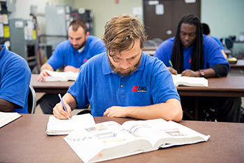 student studying in hvac class