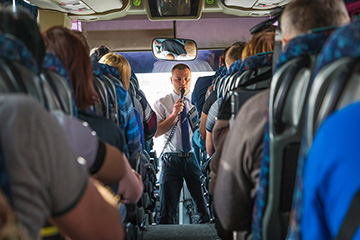 tour guide on bus