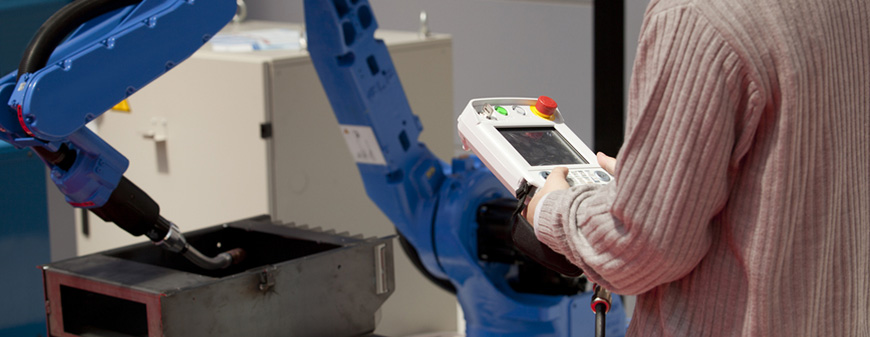welder operating robot weld machine