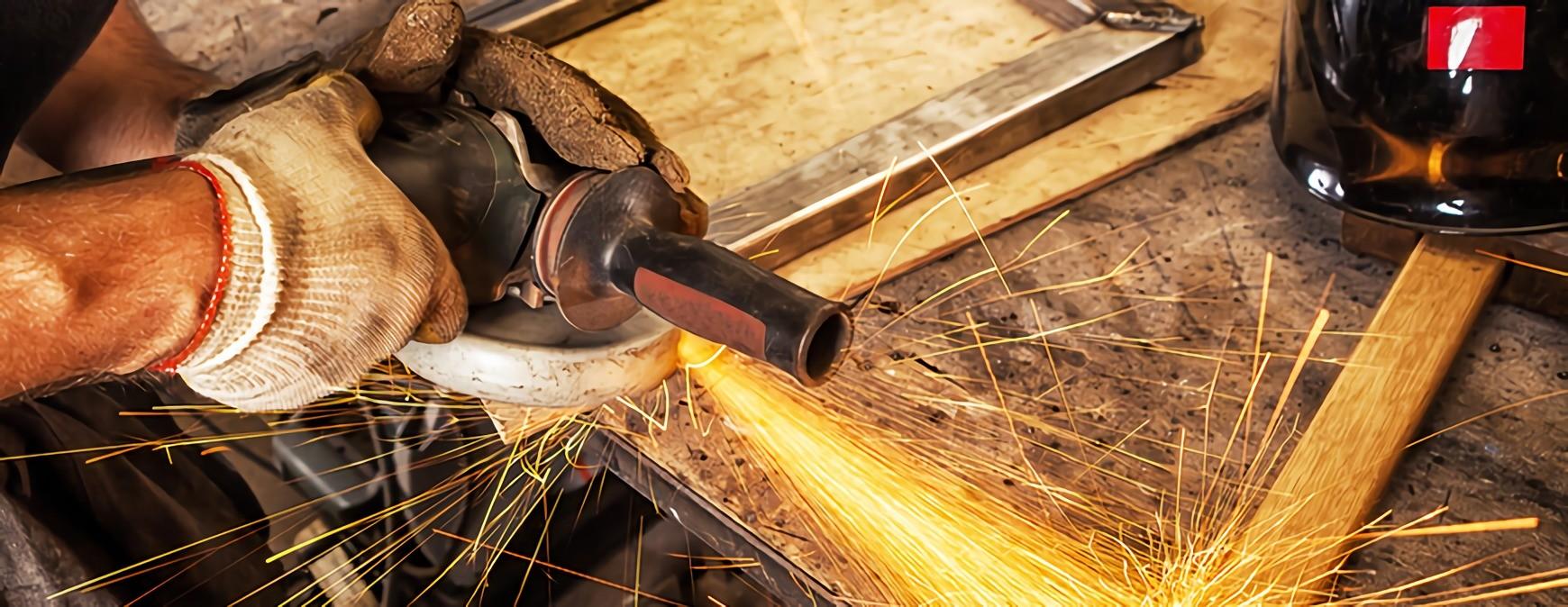 welder using angle grinder
