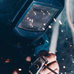 welder using welding machine