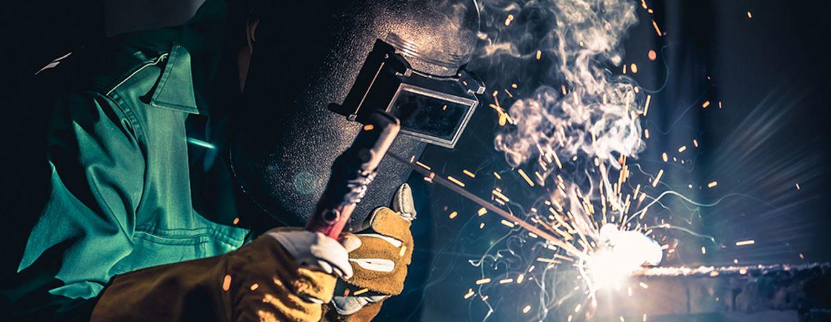 welder using welding rod
