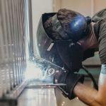 welder wearing gloves and mask