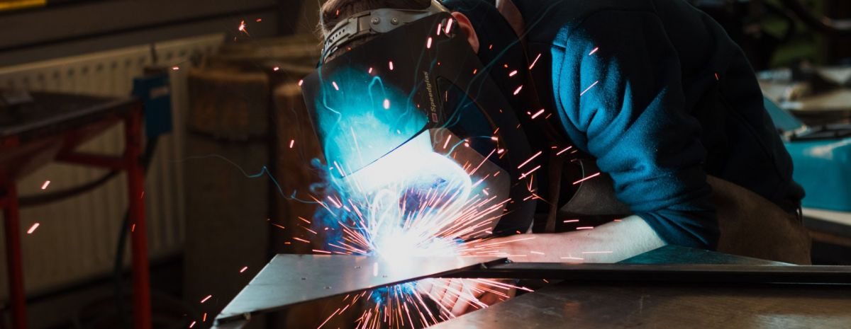 welder working as an essential worker
