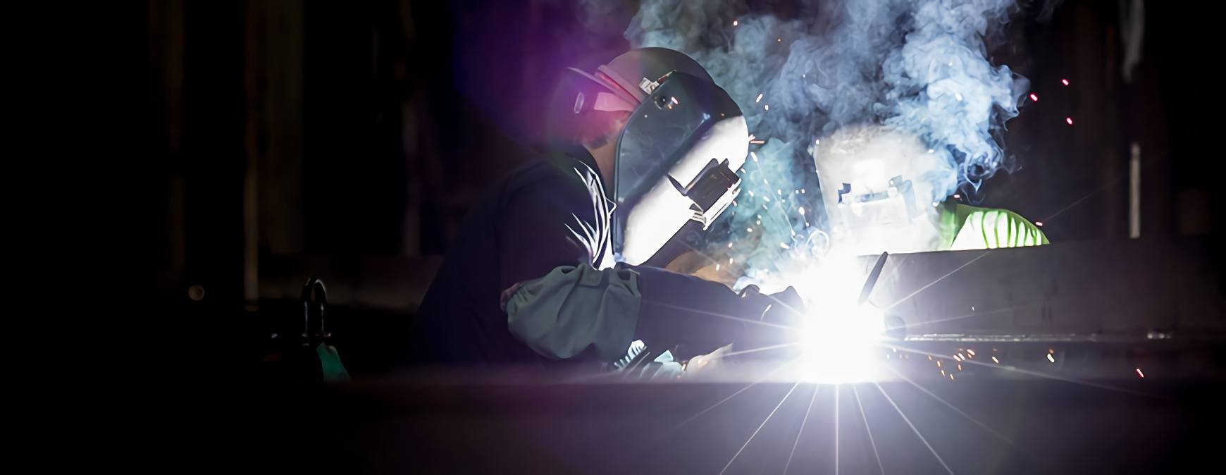 welder working in dark place