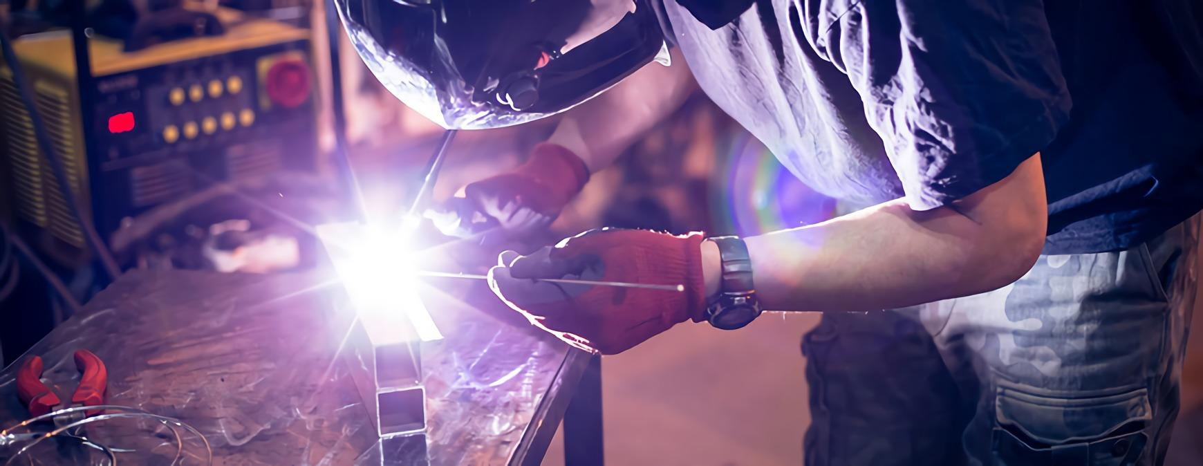 welder working on aluminum