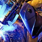 welder working on pipe