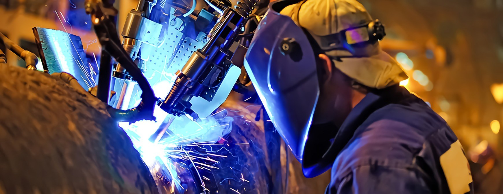 welder working on pipe