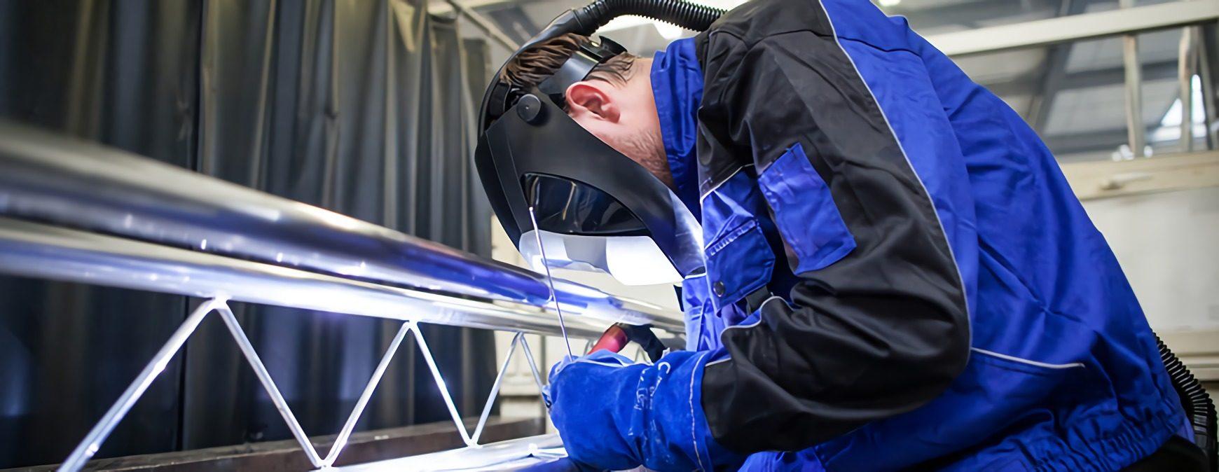 welder working on steel