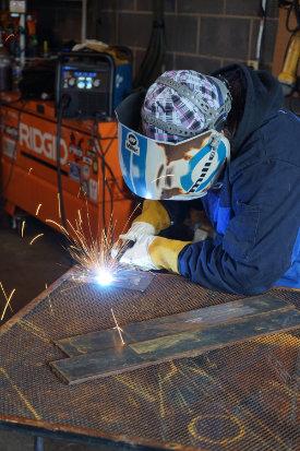 welding student in workshop