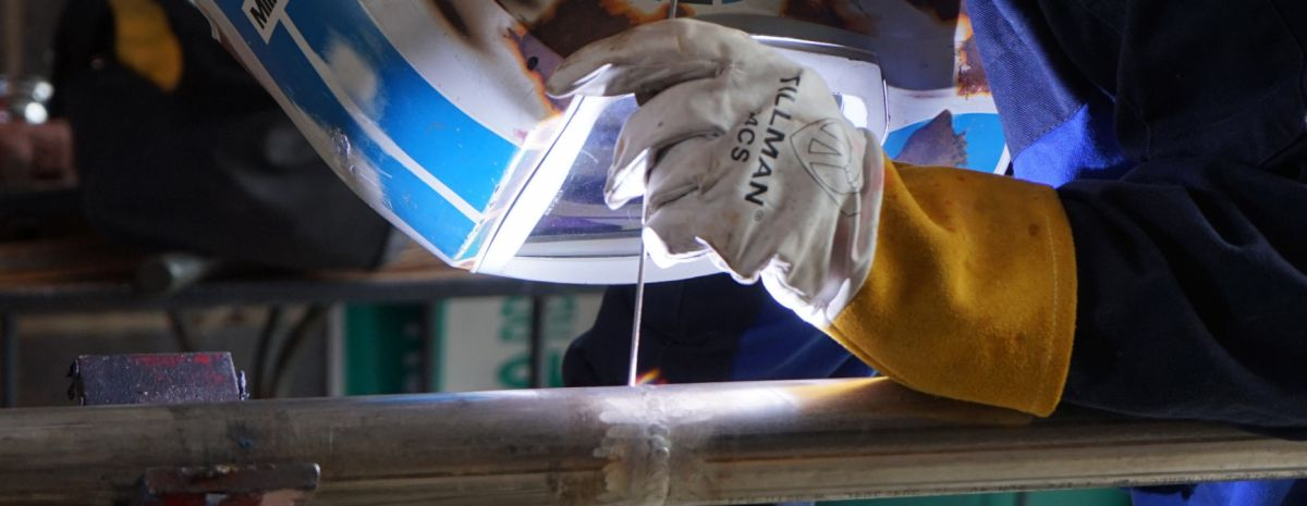 welding student welding a pipe