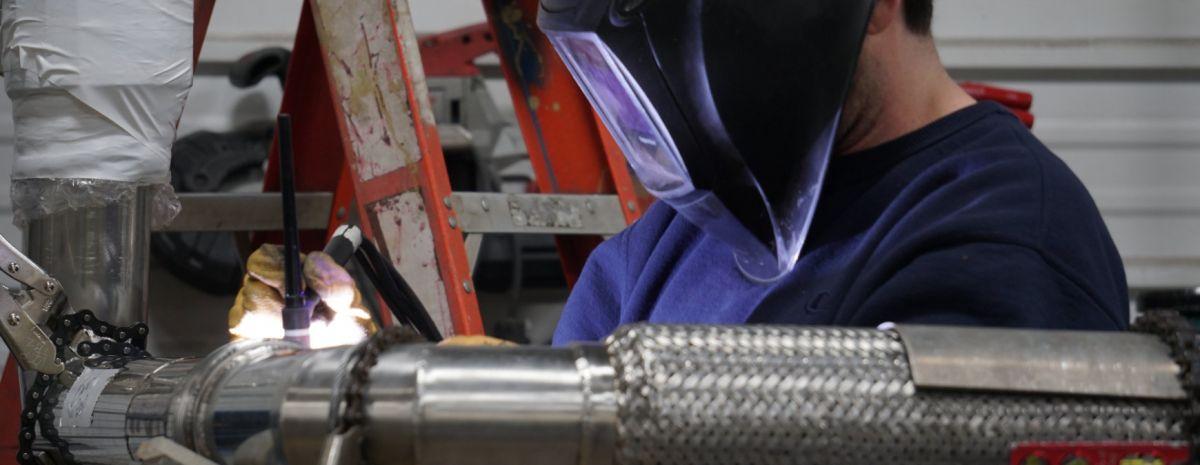 welding student working a job
