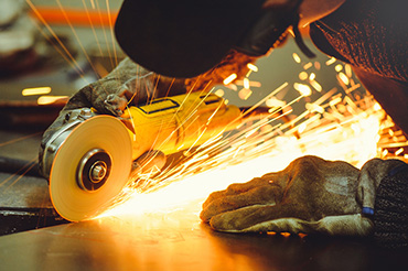 worker using angle grinder
