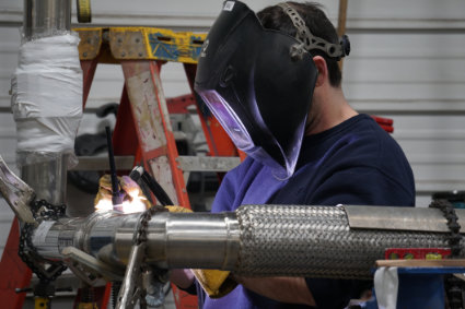 young welding student